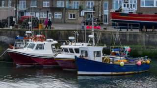 View of boats in the harbour at Seahouses