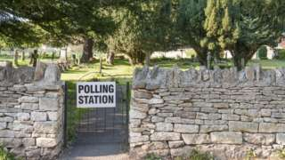 Polling station sign on gate