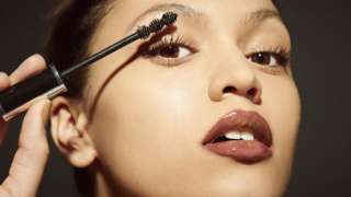 Stock shot of woman applying make up