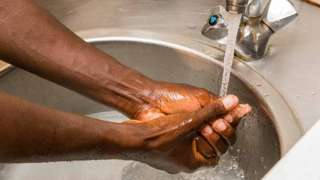 Black person washing hands