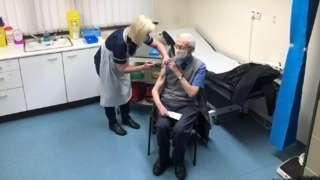Ralph Evans receives vaccine in Merthyr Tydfil