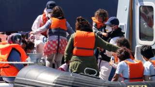 Border Force escorts a family off a boat