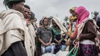Internally displaced people (IDP) camp waiting to receive food from the World Food Programme (WFP) in Debark, Ethiopia, on September 15, 2021.