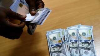 Price of US dollar no change immediately afta di ban but operators say dis no go last