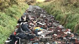 Flytipped rubbish on road