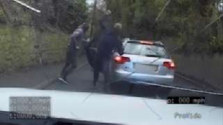 Offenders throwing stones at a police patrol car
