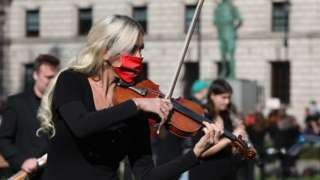 Musicians protest outside Parliament in Westminster, London