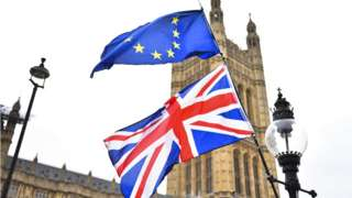 eu and uk flags outside parliament