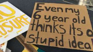 A placard used during the rally which says 'even my six-year-old think it's a stupid idea'