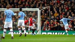 Bernardo Silva (right) scores the opener for Manchester City