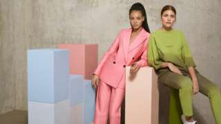 Zalando models wearing pink and green suits