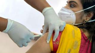 A volunteer receives the Covid-19 vaccine at a mock run in India's Karnataka