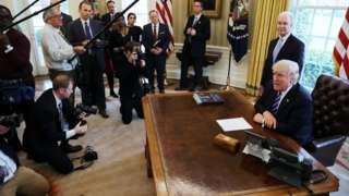Donald Trump speaks to reporters
