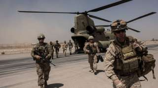 US troops walk off a helicopter on the runway at Camp Bost in 2017 in Helmand Province