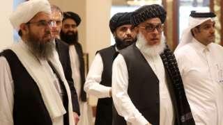 "The Taliban""s former envoy to Saudi Arabia Shahabuddin Delawar (L) arrives with Taliban Qatar spokesman Suhhail Shaheen (C, behind) and Taliban negotiator Abbas Stanikzai (C, front) to attend the Intra Afghan Dialogue talks in the Qatari capital Doha on July 7, 2019."