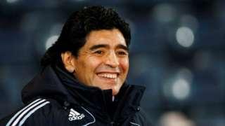 Diego Maradona smiles during their international friendly soccer match against Scotland at Hampden Park stadium in Glasgow, Scotland November 19, 2008.