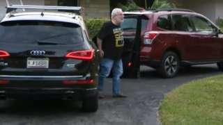 Professor Bruce Bagley gets out of a car outside his house