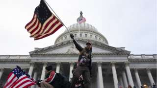 Pro-Trump protesters storm the grounds of the East Front of the US Capitol, in Washington, DC, USA, 06 January 2021. Various groups of Trump supporters have broken into the US Capitol and rioted as Congress prepares to meet and certify the results of the 2020 US Presidential election.