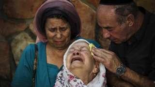 he mother of Albert Alon Govberg mourns at his funeral on October 14, 2015 in Jerusalem, Israel.