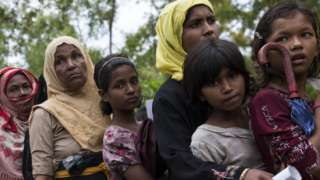 Rohingya refugee women in Bangladesh queue for food. file photo