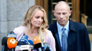 Adult film actress Stephanie Clifford, also known as Stormy Daniels, speaks to media along with lawyer Michael Avenatti (R) outside federal court in the Manhattan borough of New York City, New York, on 16 April 2018