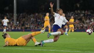 Nikita Parris of England is brought down by Caitlin Foord of Australia