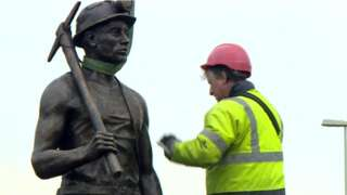 Mining statue