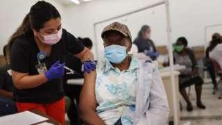 Man receives Moderna covid vaccine