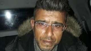 Arrest photo of Hussain