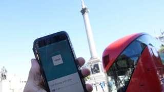 Uber app in Trafalgar Square