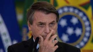 "Brazil's president Jair Bolsonaro participates in the announcement of CAIXA""s new measures to support Santas Casas and Hospitales Filantropicos, at the Palacio do Planalto in the city of Brasilia, Brazil, 25 March 2021."