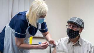 One of the early people to get a first dose of a vaccine in Merthyr Tydfil