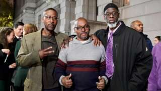 The three men pictured following their release