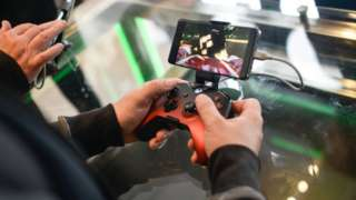A customer plays on an Xbox xCloud device at the Microsoft store opening on July 11, 2019 in London, England
