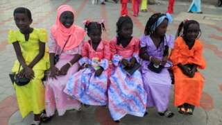 Girls wearing new clothes are pictured on the first day of Eid al-Adha in Dakar.