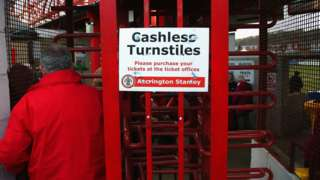A fan goes through the turnstiles at Accrington Stanley