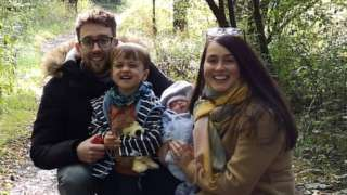 Sara, Andrew and their two children Ezra and Eliza in woodland path