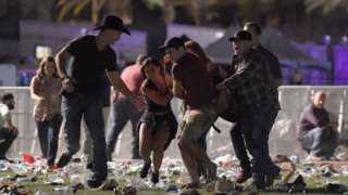 Image shows people fleeing the scene of the shooting