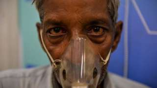 Man using nebuliser to treat asthma