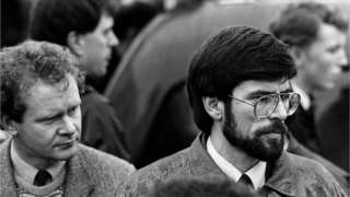 Sinn Fein President Gerry Adams (R) and his deputy, Mr Martin McGuinness look on as the hearses carrying the coffins of IRA members, Mairead Farrell, Daniel McCann and Sean Savage [IRA operatives killed in Gibraltar], set off from Dublin Airport heading for Belfast. Picture taken on 14/03/1988