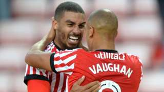 Lewis Grabban celebrates with James Vaughan