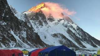 Tents at the base camp in the shadow of K2