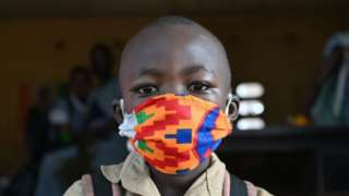 Boy wearing a colourful mask