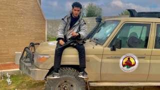 Elyas Elmehdi, with gun