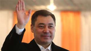 Presidential candidate Sadyr Japarov waves at the press after casting his ballot during the presidential elections in Bishkek, Kyrgyzstan, 10 January 2021