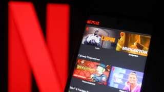 Netflix logo with Netflix on phone