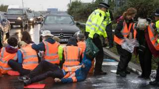 Police at M25 protest