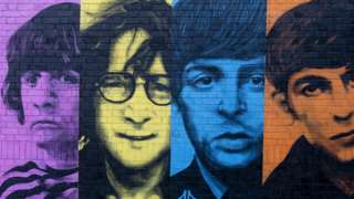 A mural of the Beatles, painted on a wall in the Baltic Triangle area of their home city, Liverpool