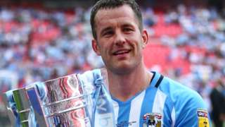 Michael Doyle celebrates Coventry's promotion to League One