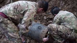 Bomb disposals experts working to make the bomb safe